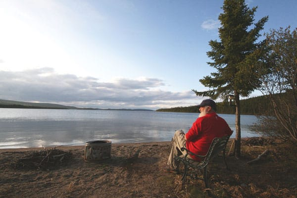 Sandra Phinney's husband, Barrie MacGregor, enjoys the view at the Grand Hermine Campground outside Labrador City, NL