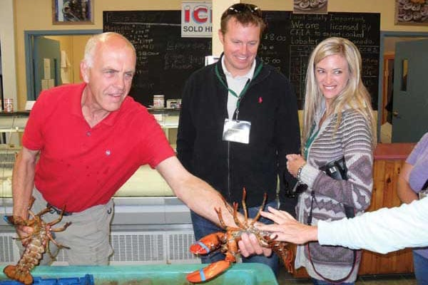 Owner Jim Larkin, of MacKinnon's Lobster Pound, offers a hands-on lobster experience.