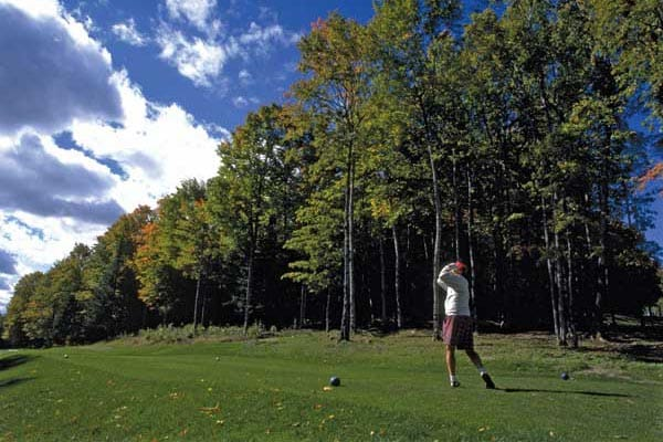 Teeing off at the Aroostook Valley Country Club, which straddles the Canada/US border