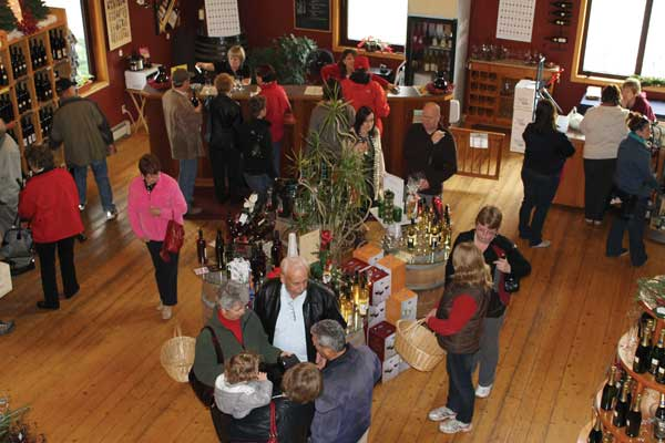 Visitors enjoy the variety of products available at Jôst Vineyards' gift shop.