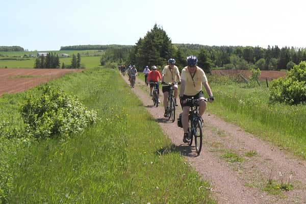 Cyclists often take a short side trip from the Confederation Trail to follow scenic trails past farmland and villages.