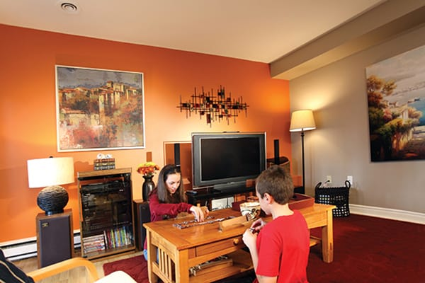 The ultimate goal of the Churchills' renovation was to create a space in their Bedford, NS, home where the family - including Megan, 13, and Christopher, 10, shown here—could relax and play games or watch movies together.