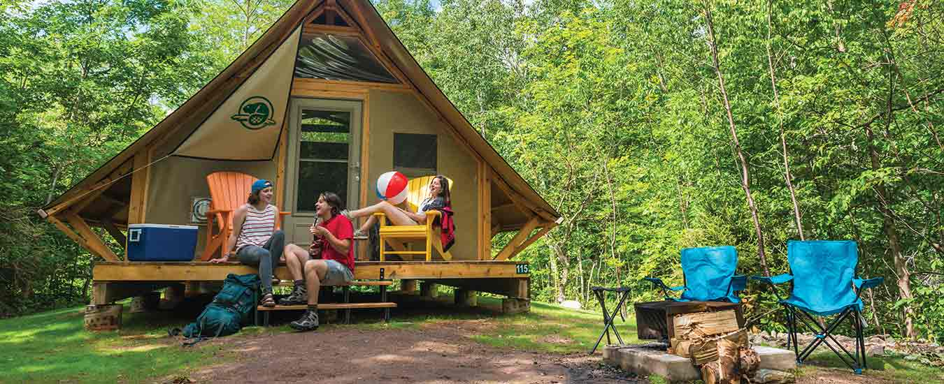 Relaxing on the steps of the oTENTiks at Cheticamp Campground, Cape Breton Highlands National Park.
