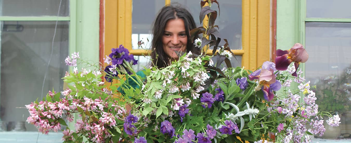 Eileen Rapsey of Hedgerow Flower Company near Weymouth, NS, with her floral creation.