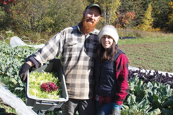 Bryan Dyck and Shannon Jones stand in their garden at Broadfork Farm, near Joggins, NS.