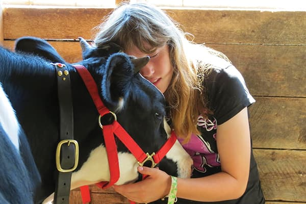 Sabrina Gilles, with Lucky, one of her two oxen