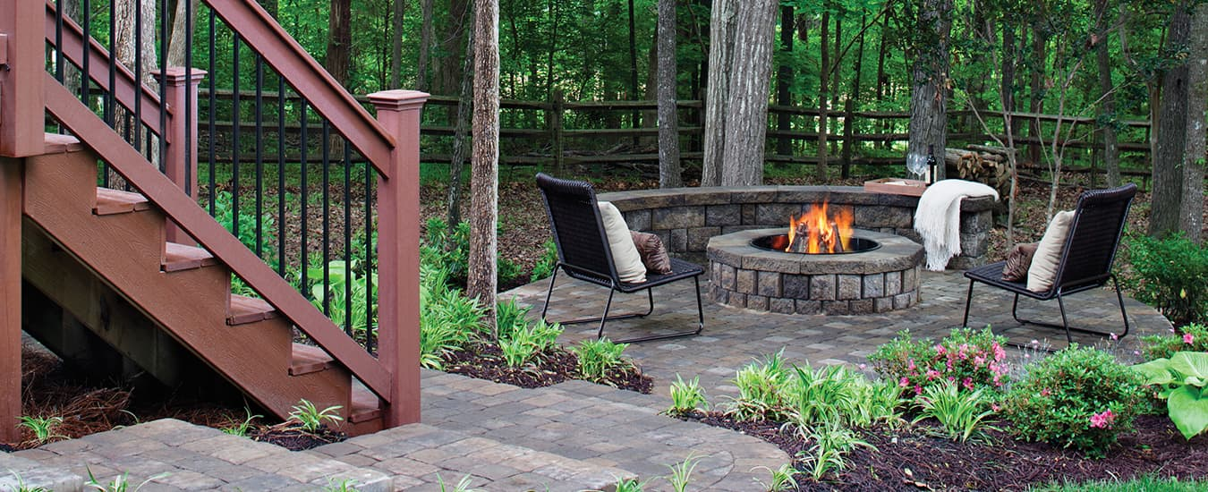 If zoning allows, a firepit area is the perfect nook for relaxing with a glass of wine.