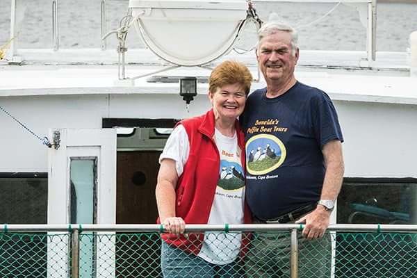 Donelda and John MacAskill aboard the Highland Lass.