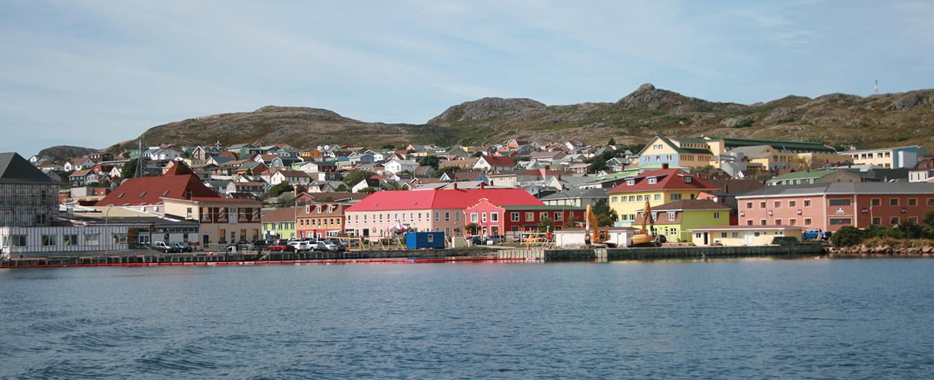 The town of Saint-Pierre is squeezed between the harbour and the hills behind.