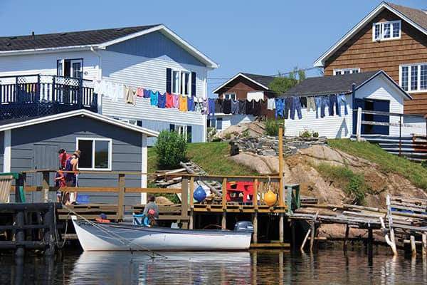 A boat moored at the end of the yard is a common sight in both Burgeo and Ramea.