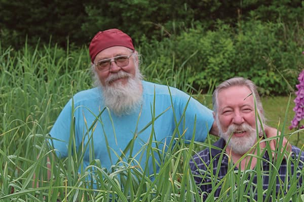 Jim Smith and Norm Plant grow four or five different varieties of garlic and harvest about 1,800 bulbs plus plenty of garlic scapes every year.