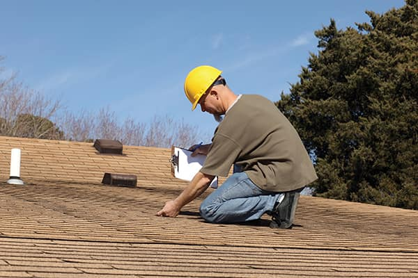 An inspector should examine the roof completely for missing or damaged shingles, ridge cap, or flashing.