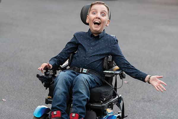 Van Morrison, an exuberant 11-year-old who lives with spinal muscular atrophy, Type 2.