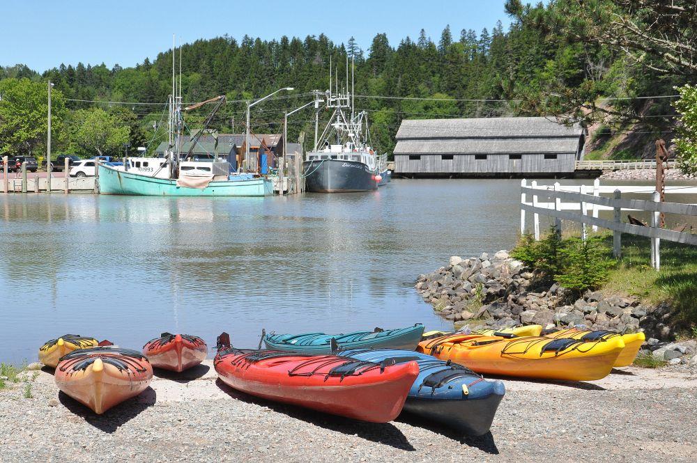 """""""kayaks and bridge"""", by Jane LeBlanc. Taken at St. Martins, N.B.."""