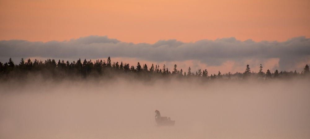 """""""Oysterman on Malpeque Bay in the early morning mis"""", by Frank Falzett. Taken at Indian River, PE."""
