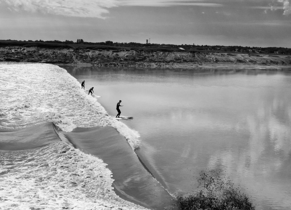 """Surf up on the Tidal bore"", by Shawn Cormier. Taken at Moncton N-B Canada."