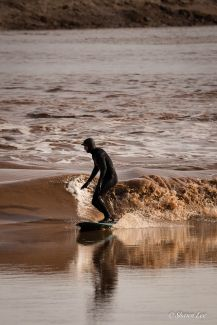Surfing the tidal bore by
