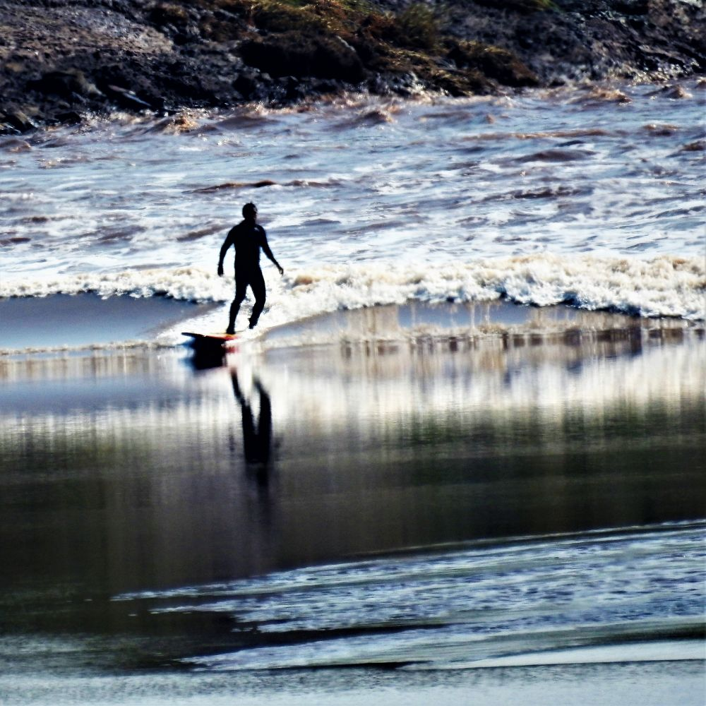 """Tidal Bore Surfer"", by Dawn MacBurnie. Taken at Tidal Bore Park, Moncton, NB."