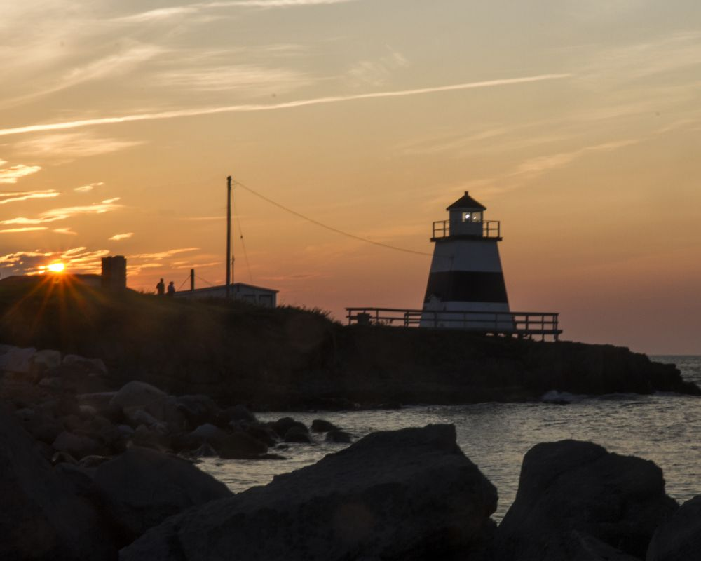 """""""Sunset Over Fundy Lighthouse"""", by Gary Bowlby. Taken at Magaretsville, NS."""