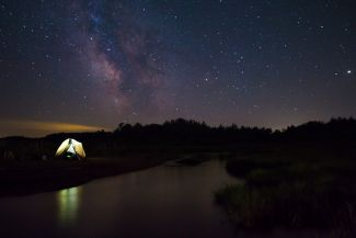 Starry night campsite over Cape Jourimain by