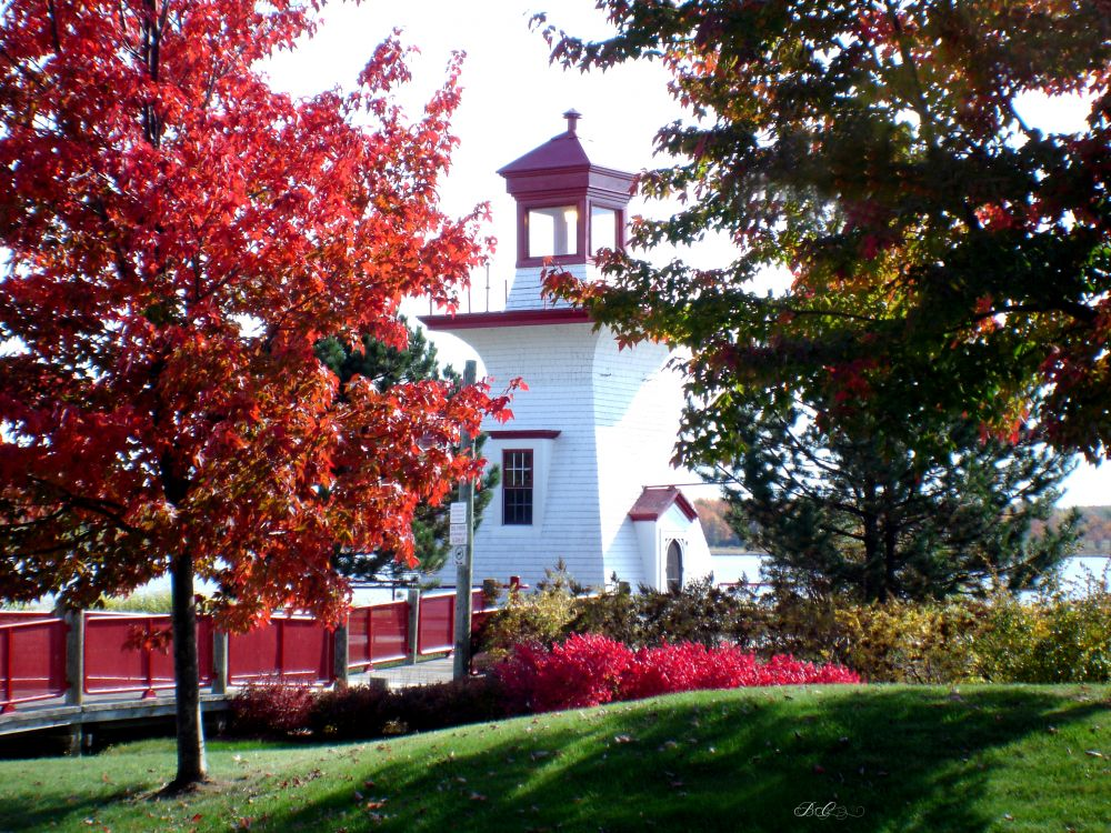 """Ritchie Wharf Lighthouse in Autumn"", by Bonnie Coughlan. Taken at Miramichi, NB."