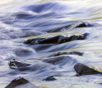 Abstract patterns in the river rapids by